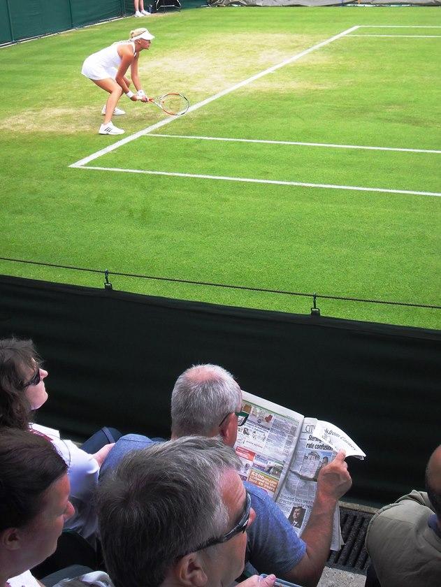 fan reading newspaper