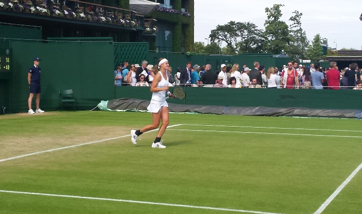 Greet after winning the match point, on her way to the net to shake opponent's hand